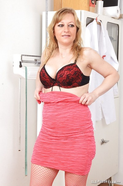Aged blonde Susan erotic dance down to nylons for speculum insertion