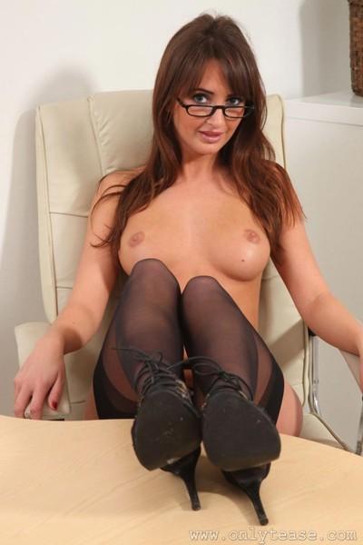 Fit brunette teasing in her office