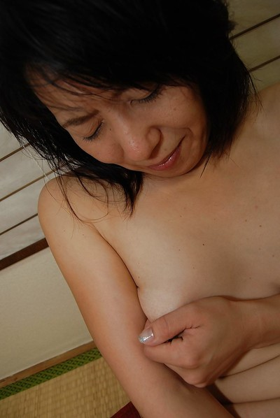 Masako Abe penetrates her Asian pussy with her favorite toys