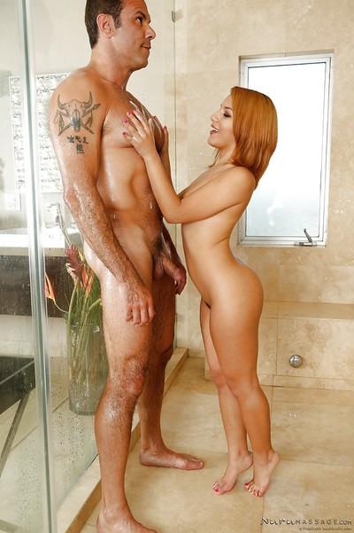 Petite redhead Liv Aguilera jerks off muscular chap in shower