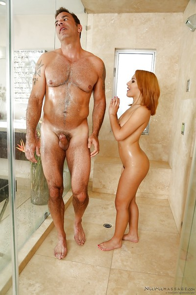 Petite redhead Liv Aguilera jerks off muscular chap in shower