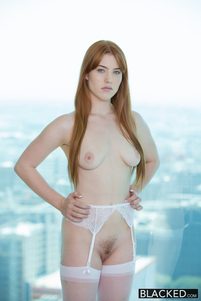 Red head beauty loves black pecker