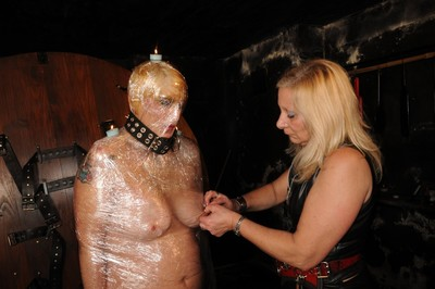 Mummified slave girl karinas female-on-female clingfilm bondage and domination in restrai