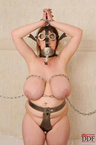 Busty gorgeous fatty girl is chained and ready for a training