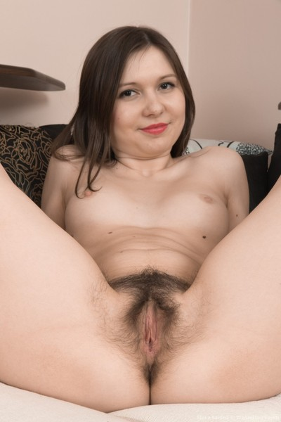 Slava sanina takes off red suit on her couch
