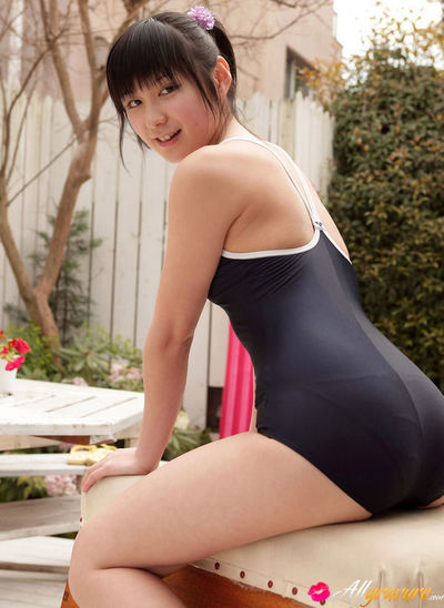 Miu Nakamura Asian in shower suit plays with water in her garden