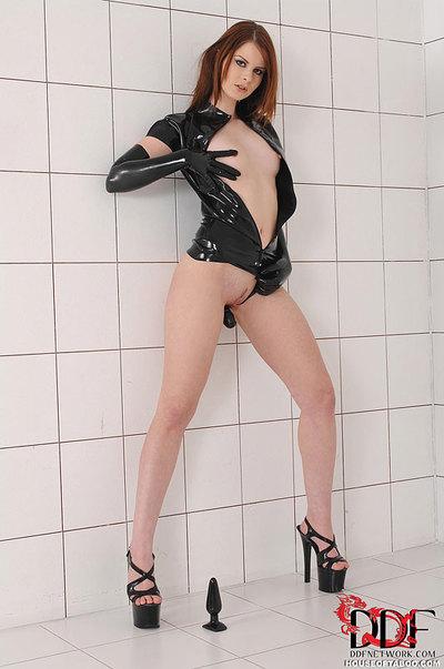 Latex garbed juvenile infatuation doll Judy Smilz masturbating with suction dildo