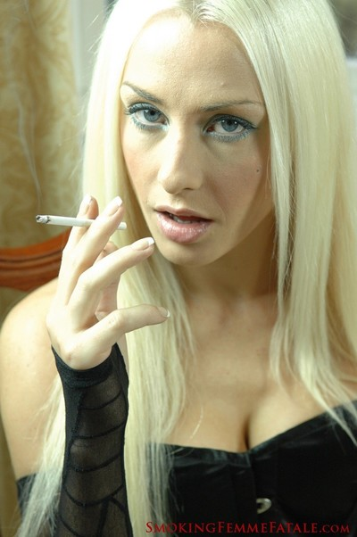 Michelle monroe smokes a 120mm cigarette in black corset