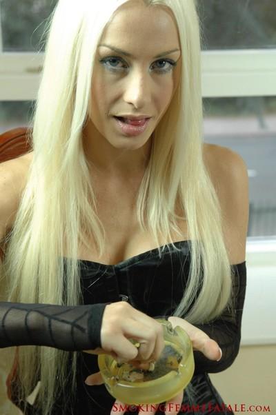 Michelle monroe smokes a 120mm cigarette in black corset