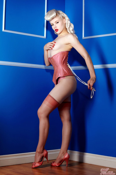 Mosh wearing a taut pink vintage corset and stockings