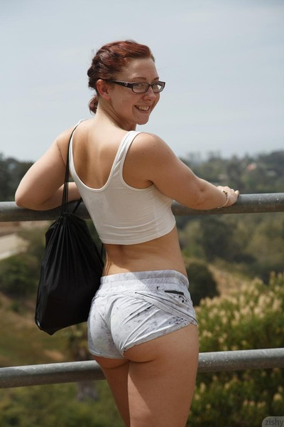 Sporty redhead hiking in the mountains