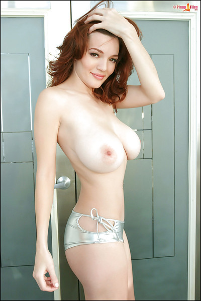 Top heavy redhead Danielle Riley showing off huge all common knockers