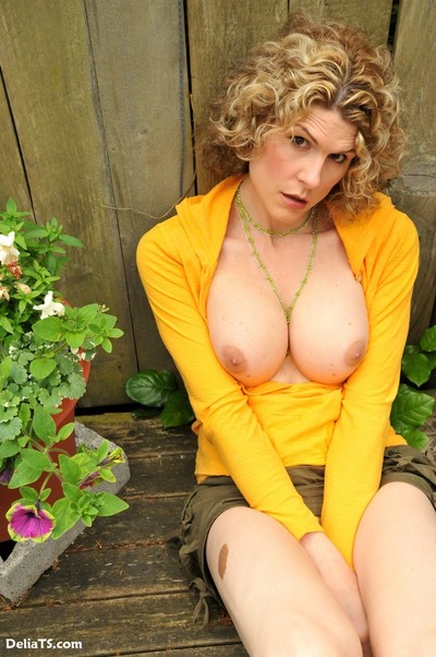 Upskirts of hung shemale delia outside watering plants