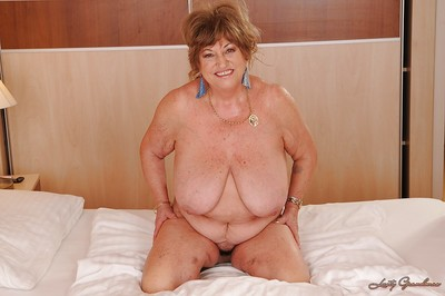 Fatty established with massive slag jugs taking off her lingerie on the bed