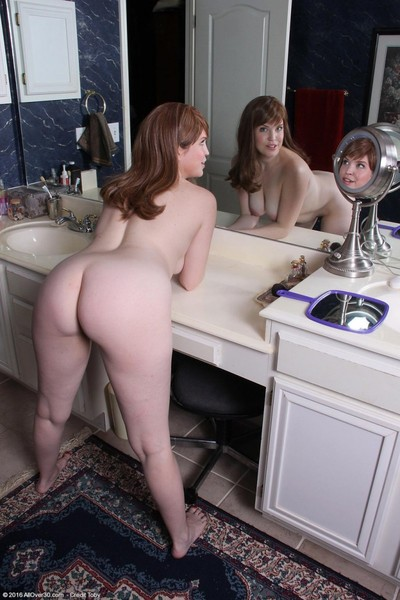 Breasty redhead housewife rubs her pussy