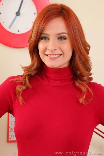 Elegant redhead strips in her office