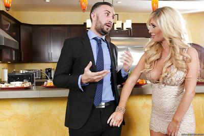 Blonde pornstar Tasha Reign on knees with cock between lusty lips