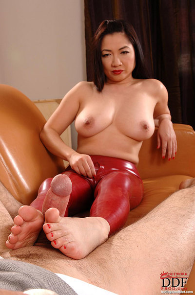 Asian babe in latex Midori Tanaka is pleasant a rod with a footjob