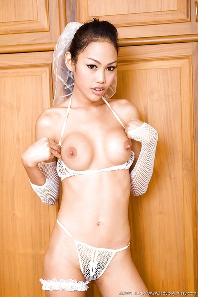Petite Thai mutated bitches Wawa stripping and showing off her bushy pussy