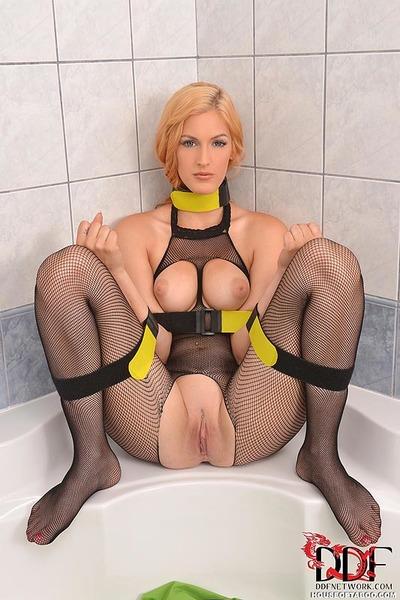 Mesh stocking attired blonde BDSM fetish model Mira Sunset pissing in bath
