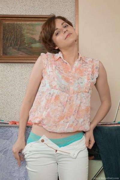 Aria strips nude by her washing machine