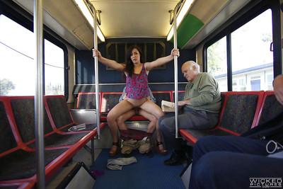 Brunette exhibitionist Anastasia Ebon giving a blowjob on public bus