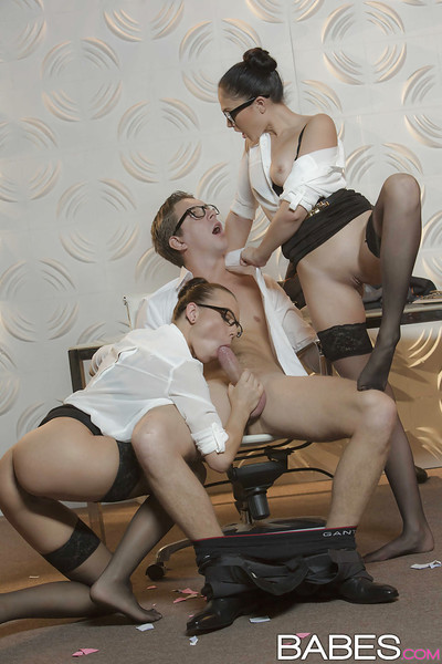 Brunette office chicks in glasses and nylons jerk off rod in threesome