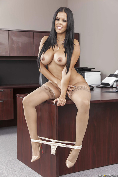 Titty secretary Diamond Kitty is posing without clothes on the working table