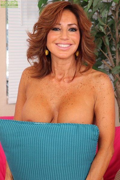 Mature Latina woman Tara Holiday flaunts her huge hooters for close ups