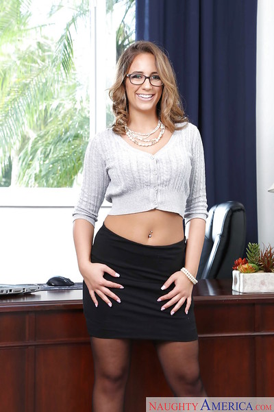 Glasses adorned babe Layla London struts in nylons and lingerie in office