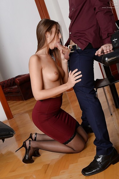 Euro secretary Suzie Moss sucking cock topless at the office