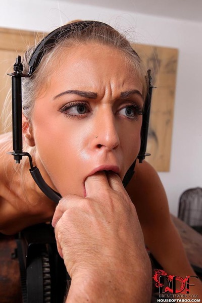 Chloe Lacourt is locked into obedience device for machine fuck and flogging