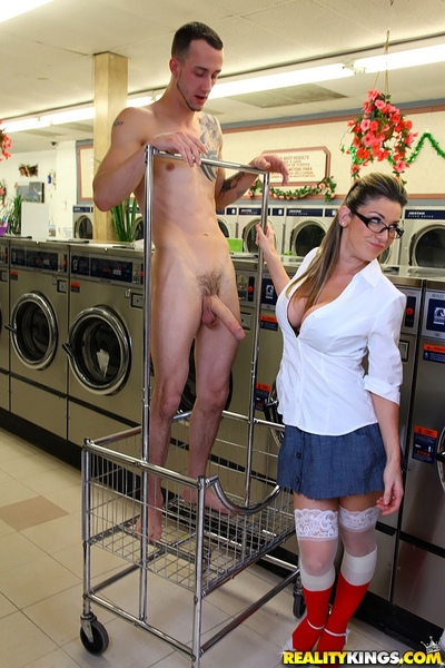 Three fully clothed MILFs milking three large cocks in the laundry