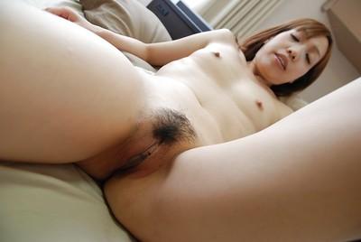 Sassy asian MILF Syoko Takaoka getting as was born and toying her hairy fur pie