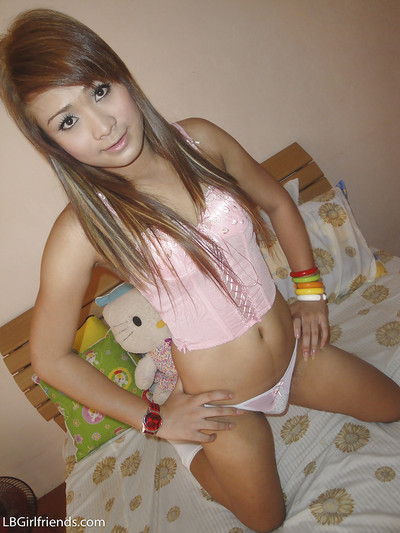 Brunette Asian shemale Aum spreading her buttocks and stroking her pride