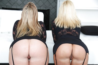 Golden-haired BBW lesbians Naughty Alysha and Dee Siren posing in black stockings