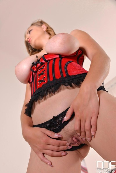 Blonde with huge tits masturbates