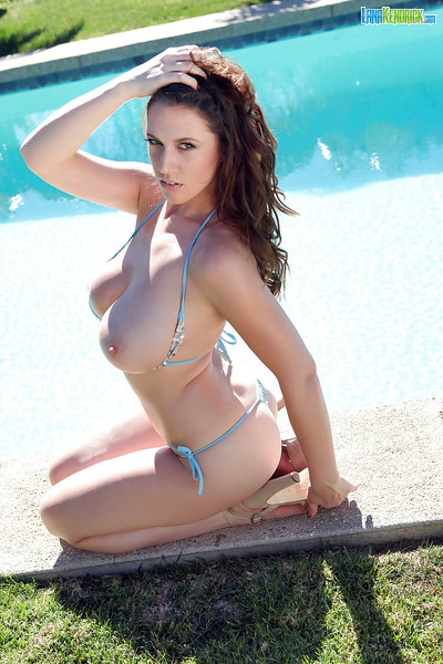 Titsy pornstar Lana Kendrick posing outdoors in string bikini