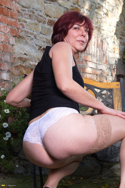 Horny mature lady playing with she