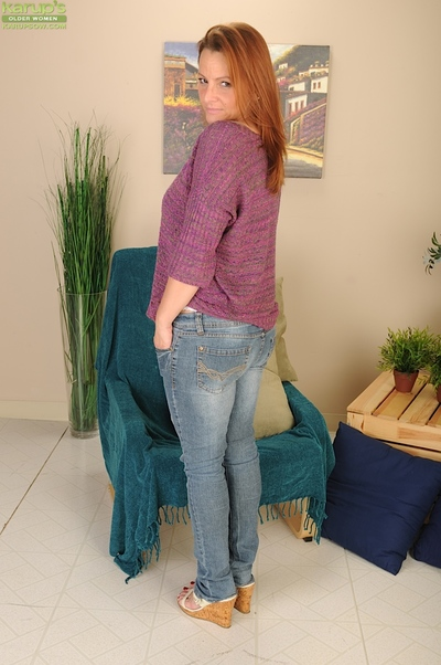 Cute milf Gia Sophia takes her jeans off and plays with hard teats