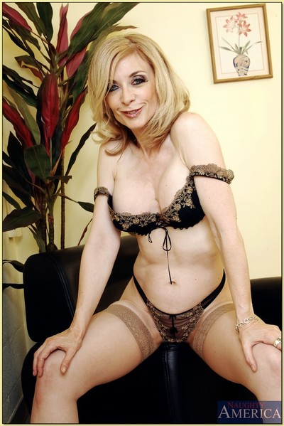 Mature lady Nina Hartley denudes grown scones and poses in stockings