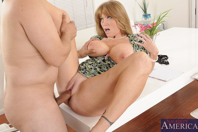 Darla Crane is horny for her sons friend so she uses her MILF talents and gets his dick hidden her pussy.