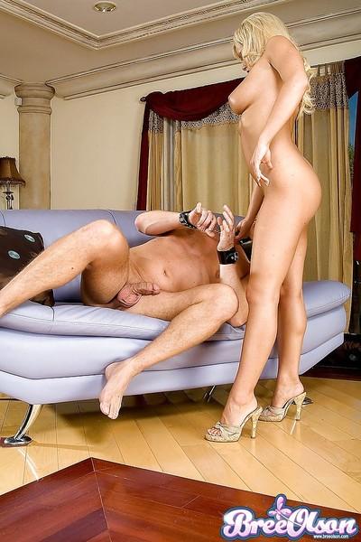 Busty blonde pornstar Bree Olson takes cumshot from stallion in constraints