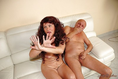 Kinky granny benefits from her unshaved cum-hole fisted and fucked with toys