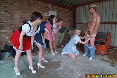 Hunky farm boy is stripped and wanked by four stunning milk maids