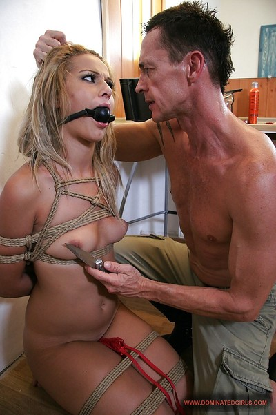Golden-haired babe smoking with a gag in her maw in a dirty Fuck and play activity