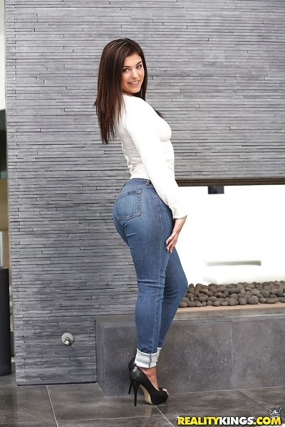 Teen babe Leah Gotti poses clothed in jeans earlier than baring phat gazoo and tits