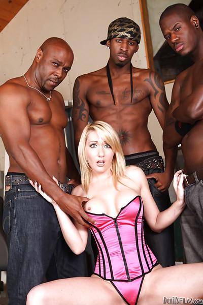Sensible milf Missy Woods satisfies three big brown males in cooperation