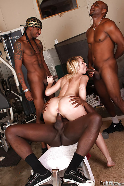 Sensible milf Missy Woods satisfies three big brown males in cooperation