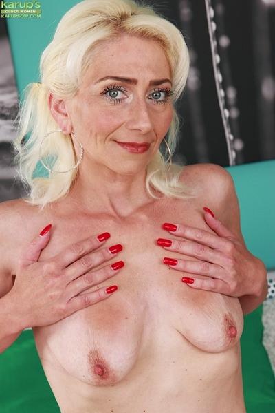 Small fairy woman Janotova pulling panties aside to masturbate cage of love